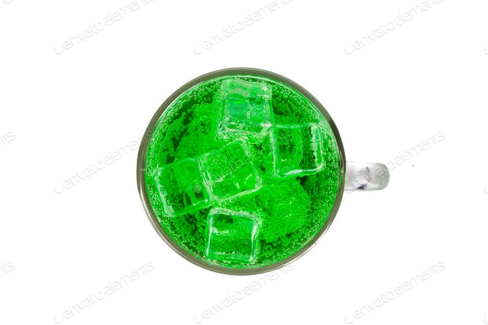 Refreshing green fizzy soft drink with ice in transperant glass