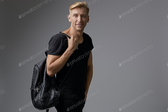 Portrait smilingyoung man with backpack