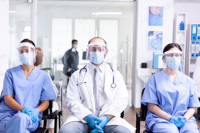 Medical staff in clinic waiting area