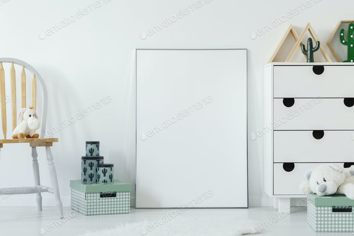 Plush toy on wooden chair next to white empty poster with mockup