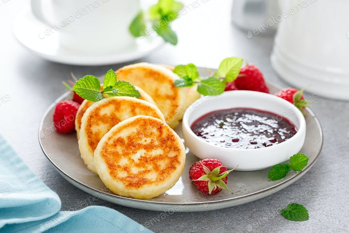 Cottage cheese pancakes, sweet curd fritters with berries, syrniki