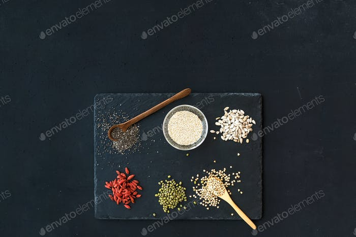 Superfoods on black chalkboard background