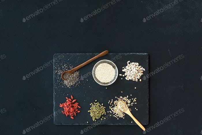Superfoods on black chalkboard background