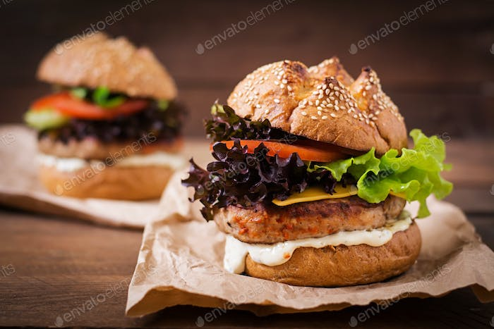 Big sandwich - hamburger with juicy turkey burger, cheese, tomato and tartar sauce