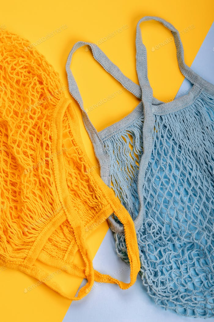 Yellow and blue string reusable bags