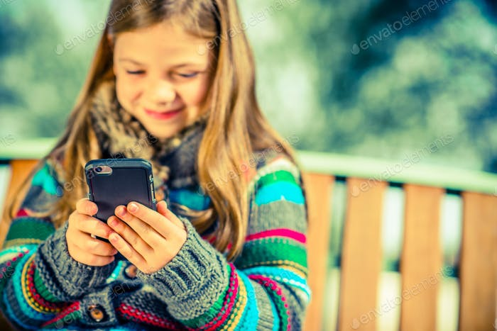 Girl Playing Cell Phone