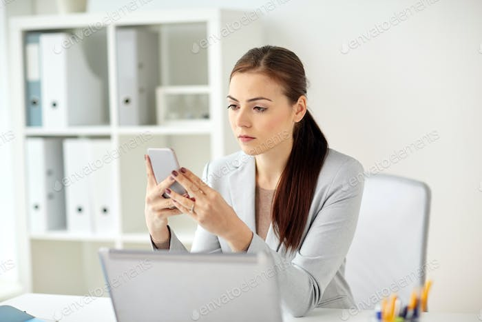 businesswoman with smartphone at office