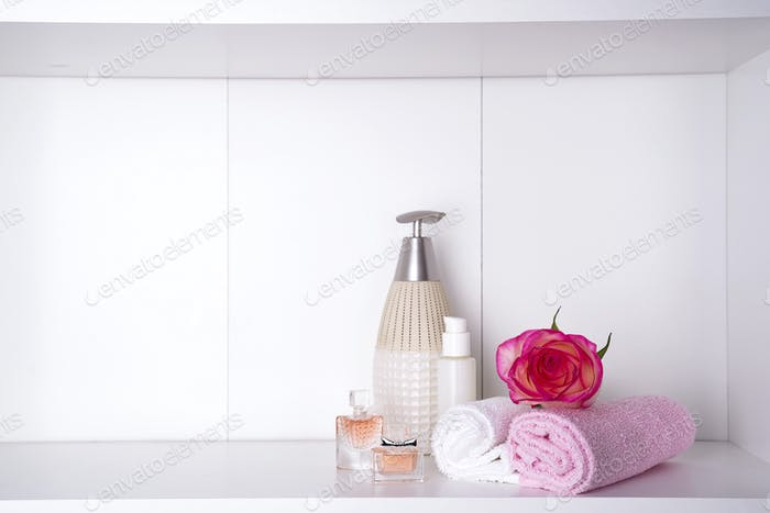 Spa bath cosmetic and flower rose, isolated on white. Dayspa nature products