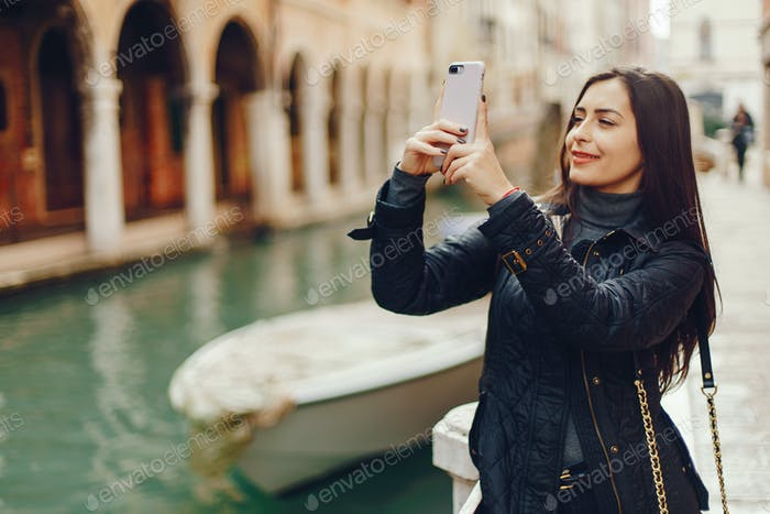 Thumbnail for girl talking on the phone and taking pictures in Venice
