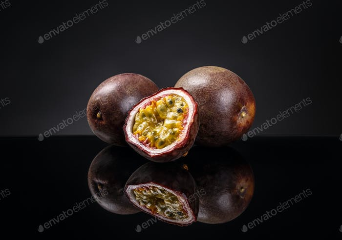 Whole and half passion fruits