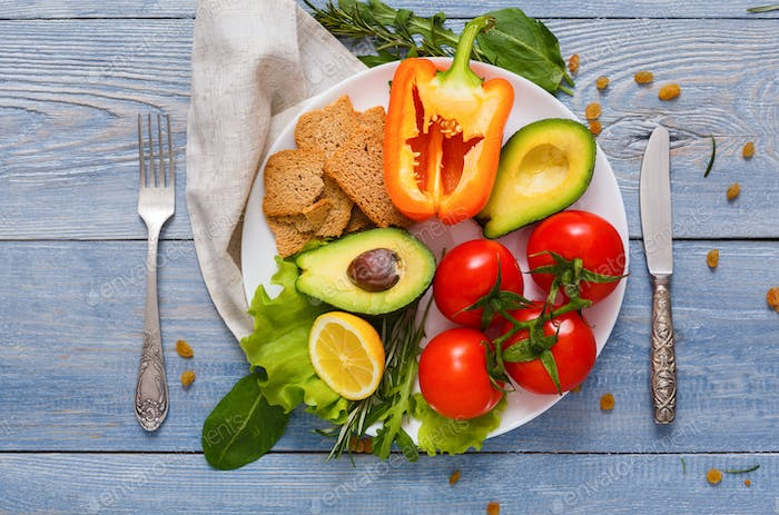Healthy eating background, top view on white plate