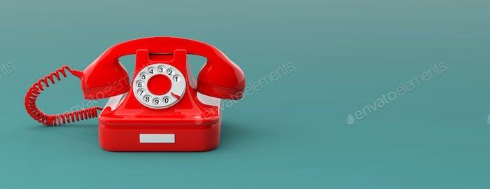 Rotes Vintage-Telefon isoliert auf grünem blauem Hintergrund, Kopierraum, Banner.