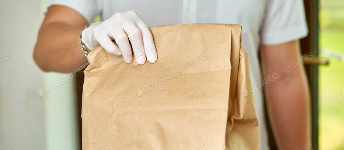 Courier delivers online purchases to the door during the coronavirus epidemic