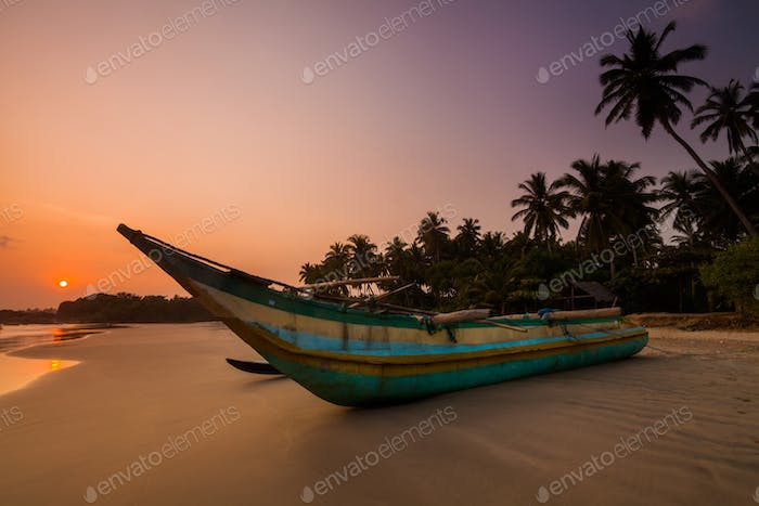 Fishing boat on the beach at sunset. Sri Lanka