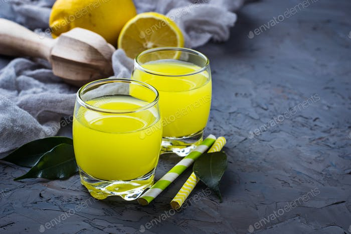 Fresh lemon juice on concrete background