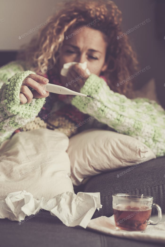 Woman at home with fever and flu