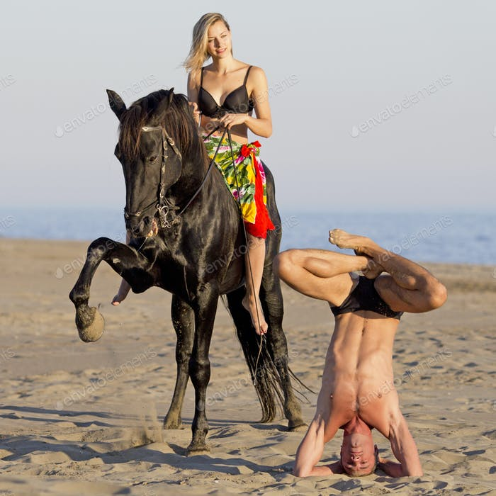 horsewoman and yogi on the beach