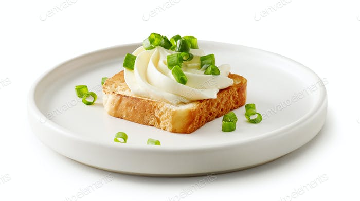 plate of toasted bread with cream cheese