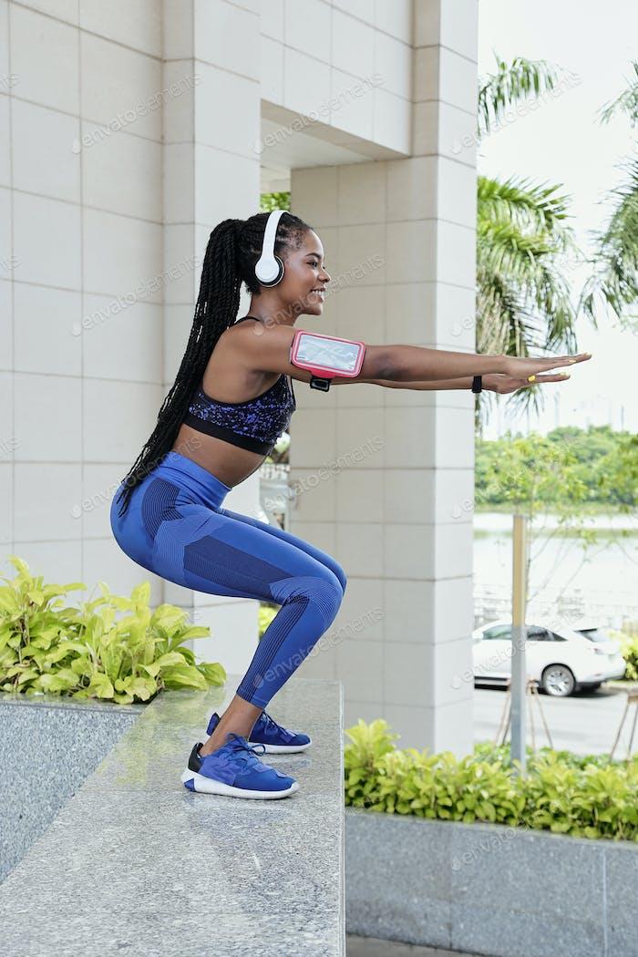Sportswoman doing squats