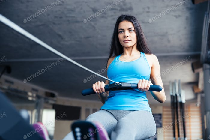 Woman working out on training simulator