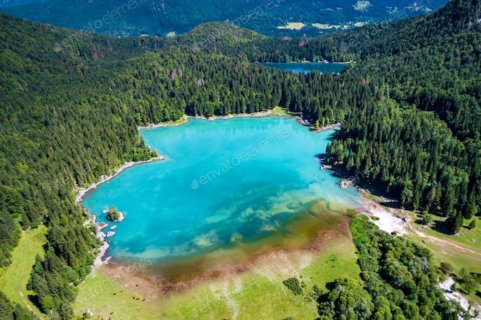 Lake Lago di Fusine Superiore Italy Alps. Aerial FPV drone fligh