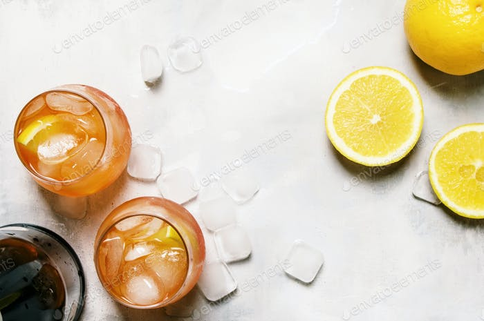 Cocktail With Aperitif Named Aperol Spritz With Bitter, Ice, Sparkling Wine And Orange Slice