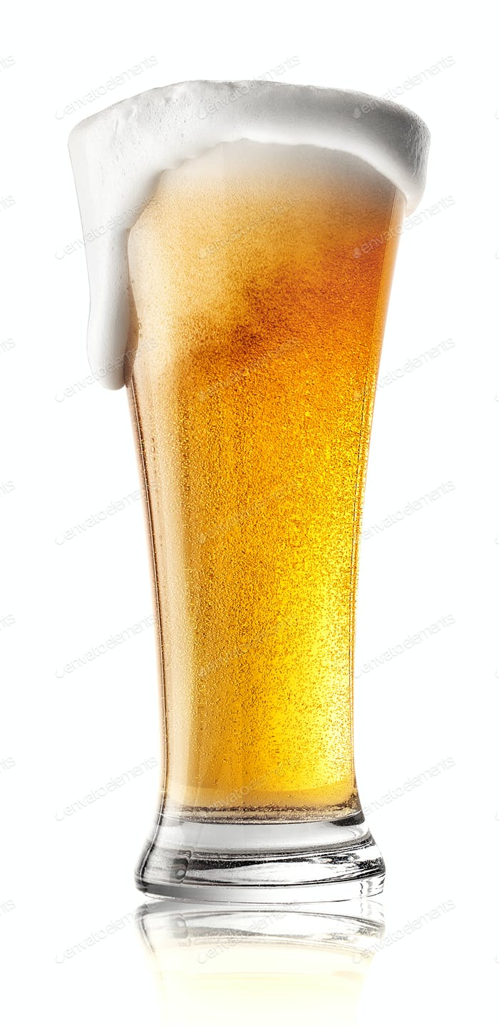 Tall glass of beer with foam spilling