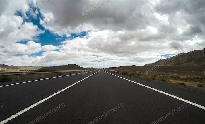 Ground beautiful view of long way straight asphalt road