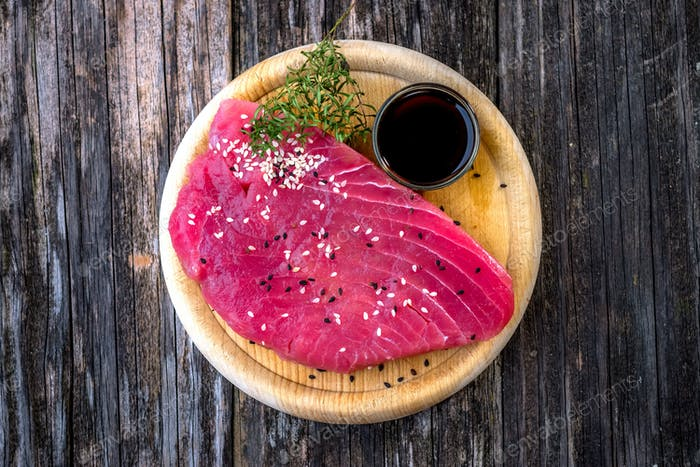 Raw tuna fillet with soya sauce  on rustic background