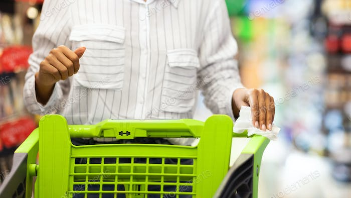 Black Lady Disinfecting Shopping Cart Buying Food In Grocery Shop