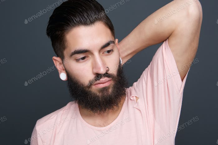 Fashion model with beard and piercing