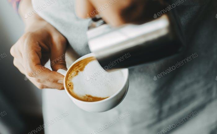 Barista making classic cappuccino