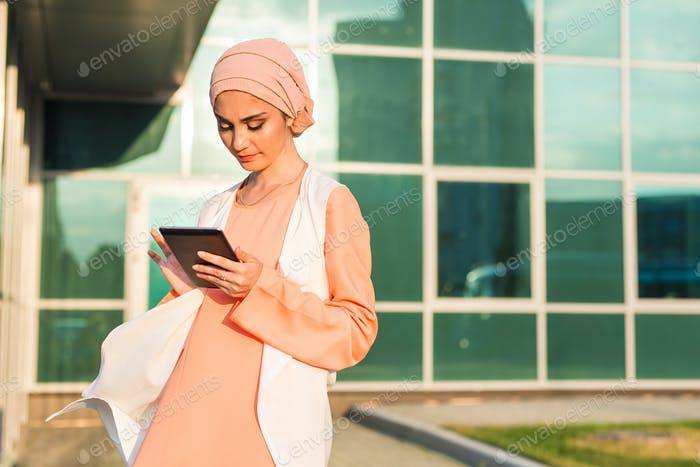 modern Arabian woman with tablet computer