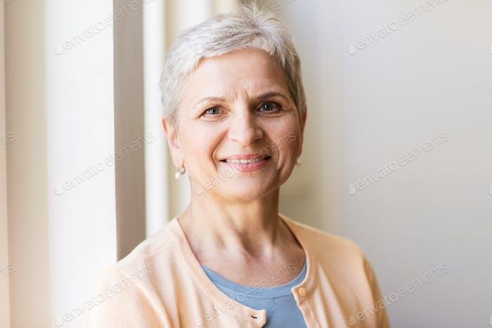 portrait of happy smiling gray senior woman