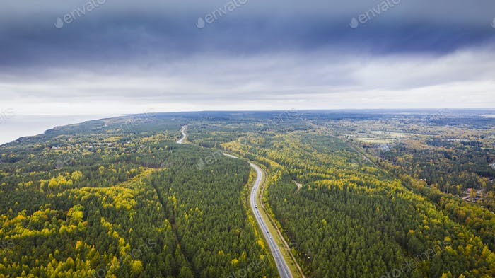 Aerial view of a car on the road Autumn landscape countryside