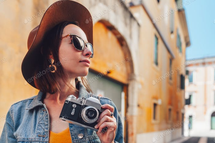Attractive photographer in Italy