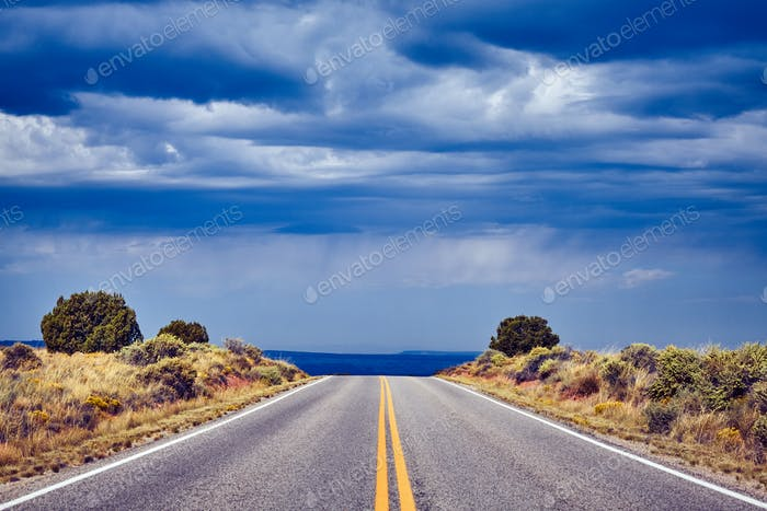 Empty road with dramatic sky, travel concept.