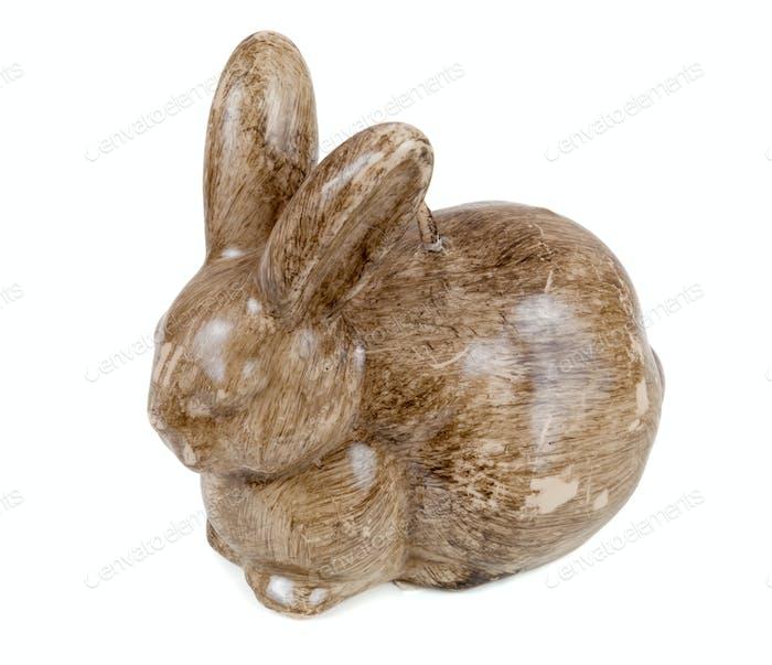 Kaninchenförmige Kerze auf weißem Hintergrund