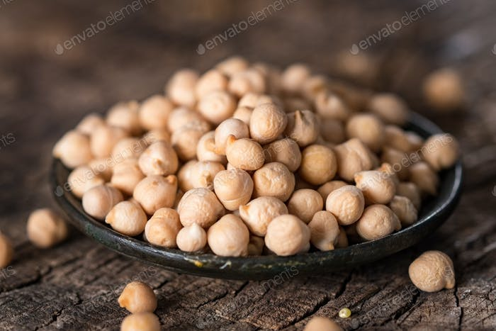 Organic chickpea on wooden  background