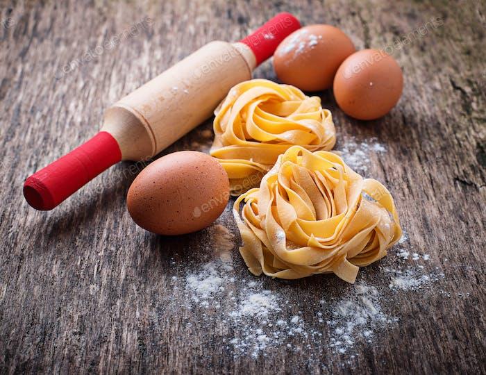 Raw pasta tagliatelle and eggs