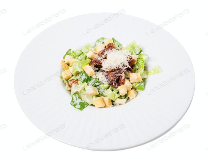 Delicious caesar salad with duck leg.