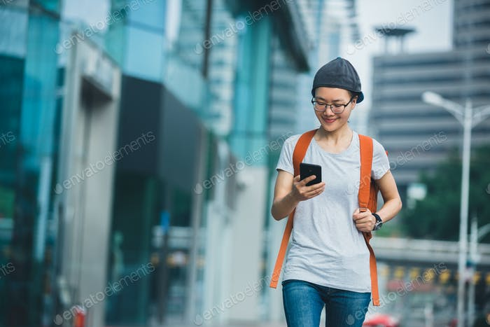 Walking with mobile phone in hand