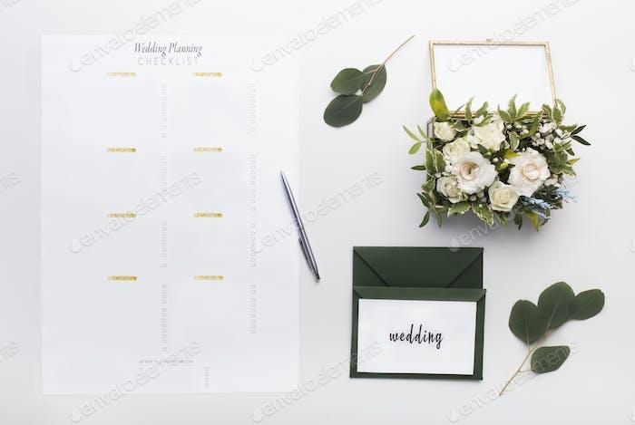 Wedding planning checklist with postcards on white background