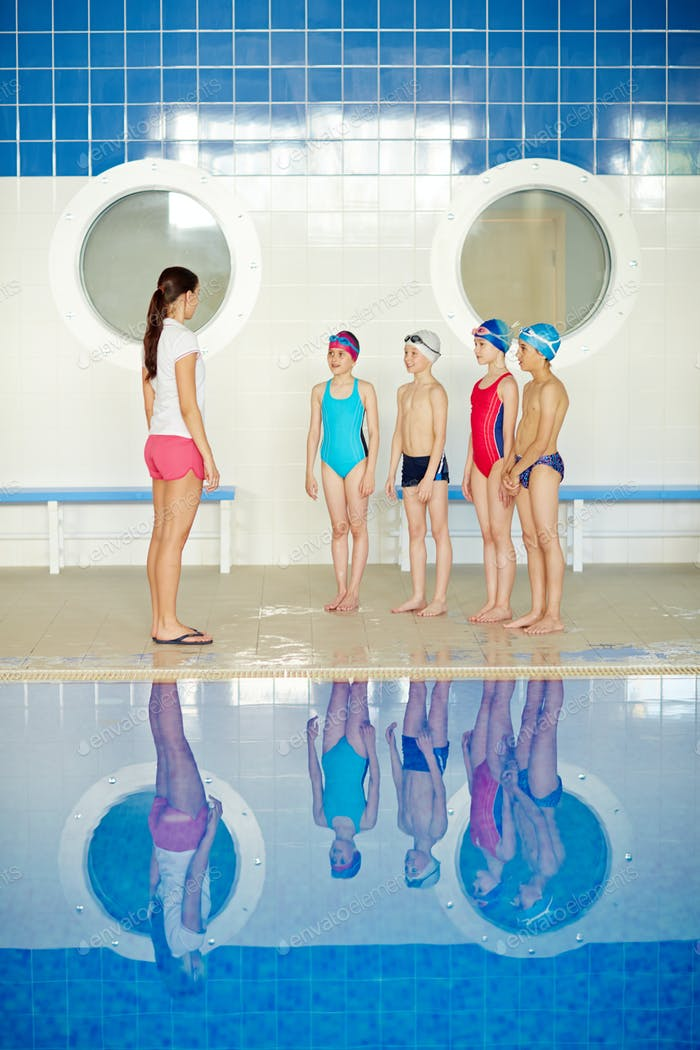 Swimmers with teacher
