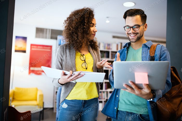 Group of college students studying in the school library