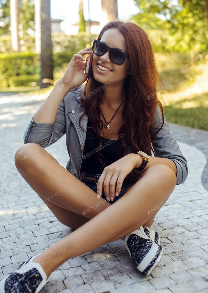 Sexy young female in sunglasses.