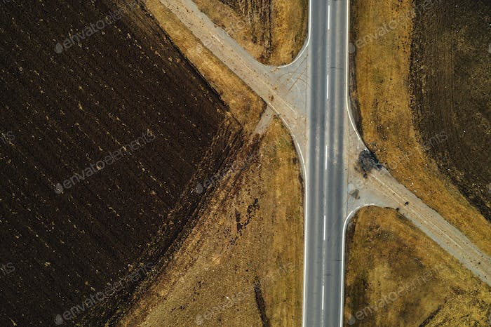 Aerial view of empty road through countryside landscape