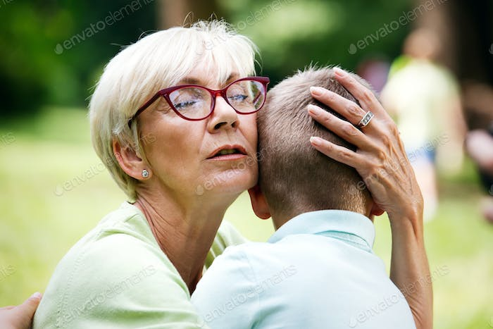 Happy cute grandmother with grandson together outdoor