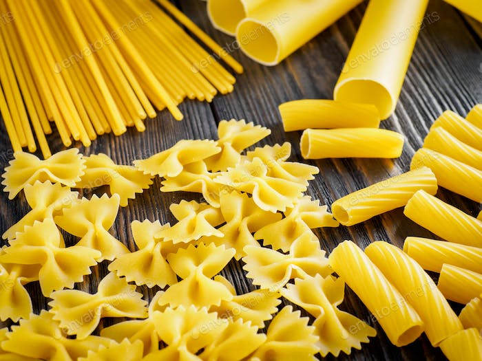Mix of different kind of paste - spaghetti, tortiglioni, cannelloni, farfalle, butterflies
