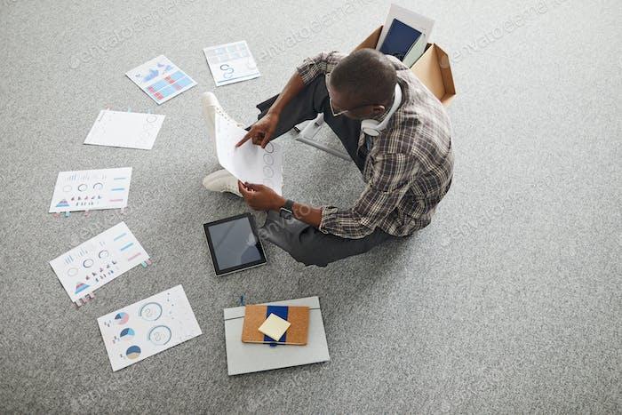 Businessman examining the charts